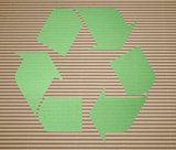 Green recycling on corrugated cardboard with background
