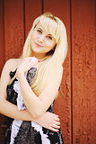 outside portrait of a  blond hair young girl