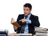 Man teacher reading pointing book