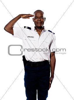 Portrait of police officer saluting