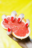 Woman Hand Squeezing a grapefruit