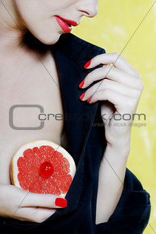 Beautiful Woman Portrait Showing grapefruit breast