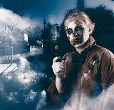 Monster in cemetery holding gun. Grave robber