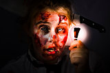 Scary zombie with Halloween idea light bulb