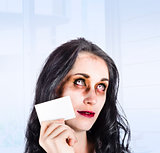 Zombie business person thinking with business card