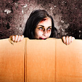 Scary zombie girl advertising halloween price cut