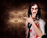 Eerie woman pointing to Halloween copyspace