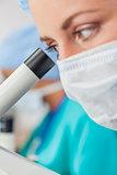 Female Woman Scientist Using Microscope in Laboratory