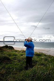 A senior lady on the coastal path