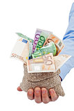 Businessman hand with a bag full of euro banknotes