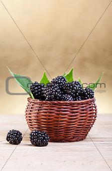 Fresh blackberries in small basket