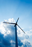 Close up of wind turbine against dramatic clouds
