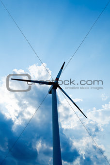 Close up of wind turbine against dramatic clouds