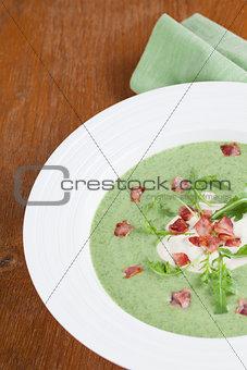 Arugula cream soup with sour cream and bacon