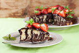 Marble cake with chocolate glaze and strawberries