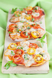 Mini pizzas with mozzarella and cherry tomatoes