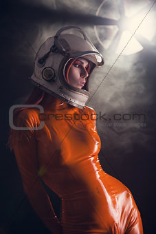 Portrait of sexy girl in orange latex catsuit