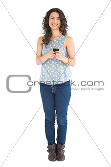 Cheerful attractive brunette texting