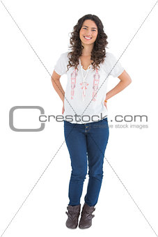 Smiling attractive brunette wearing casual clothes posing