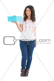 Content casual brunette holding a present