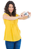 Content curly haired brunette taking picture of herself