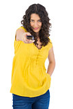 Curly haired pretty woman holding remote