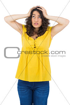 Anxious casual young woman posing
