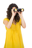 Casual young woman using binoculars
