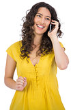 Cheerful casual young woman on the phone