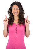 Smiling brown haired woman pointing out