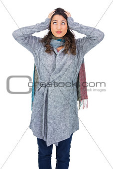 Anxious pretty brunette wearing winter clothes posing