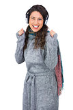 Gorgeous model with winter clothes dancing while listening to music