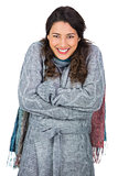 Smiling gorgeous model with winter clothes being cold