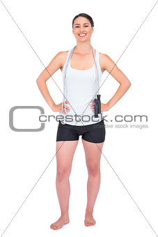 Cheerful slender model with her jump rope on shoulders