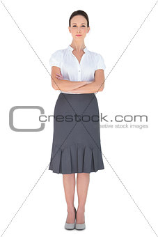 Peaceful businesswoman posing crossing arms