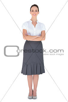 Cheerful businesswoman posing crossing arms