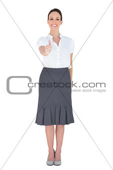 Happy businesswoman posing thumb up