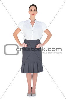 Serious attractive businesswoman posing