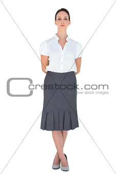 Stern attractive businesswoman posing