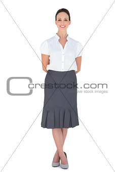 Smiling elegant businesswoman posing