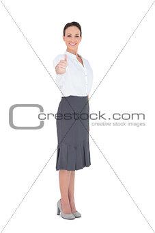 Elegant businesswoman posing thumb up