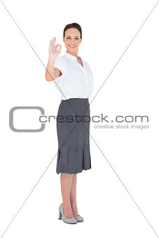 Elegant businesswoman showing an okay gesture