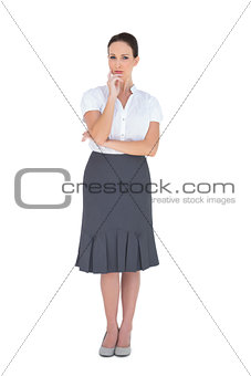 Thoughtful elegant businesswoman posing