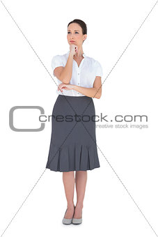 Pensive elegant businesswoman posing