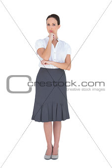 Pensive gorgeous businesswoman posing