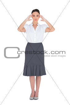 Apprehensive gorgeous businesswoman posing