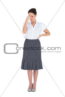 Uneasy gorgeous businesswoman posing
