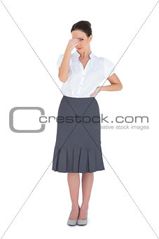 Worried gorgeous businesswoman posing