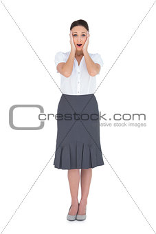 Shocked gorgeous businesswoman posing
