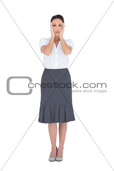 Troubled gorgeous businesswoman posing